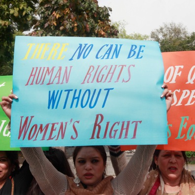 Women hold up signs during an International Women's Day rally in Lahore, March 8, 2015. REUTERS/Mohsin Raza (PAKISTAN - Tags: SOCIETY) - RTR4SI82